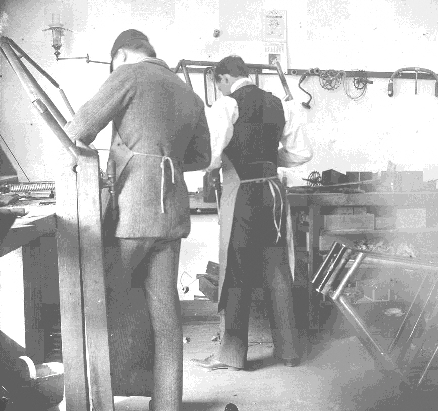 The Wright brothers working in their bicycle shop